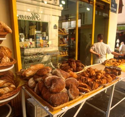 Fresh bread at open market - Food Wine Paris - Delectable Destinations
