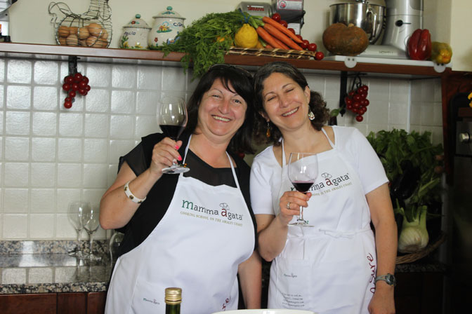 Tasting some exquisite red wine at Mamma Agata's cooking school - Ultimate Girl's Getaway Culinary Tours - Delectable Destinations - Carol Ketelson